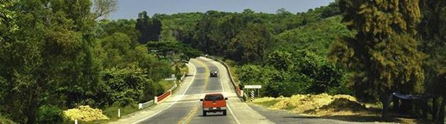 Veracruz highway with red pickup truck
